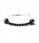 Bracelet doré avec perles Iolite Noires